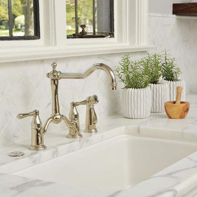 the tresa twohandle bridge kitchen faucet with side sprayer in brilliance polished nickel by brizo offers traditional yet timeless design