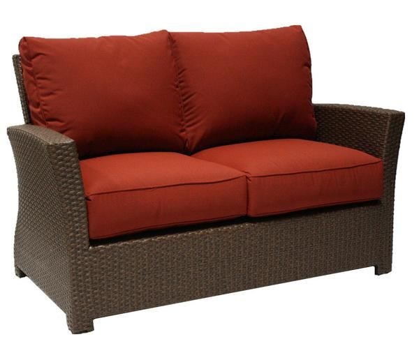 Wicker love seat made with Sunbrella fabric from the Evans Lane