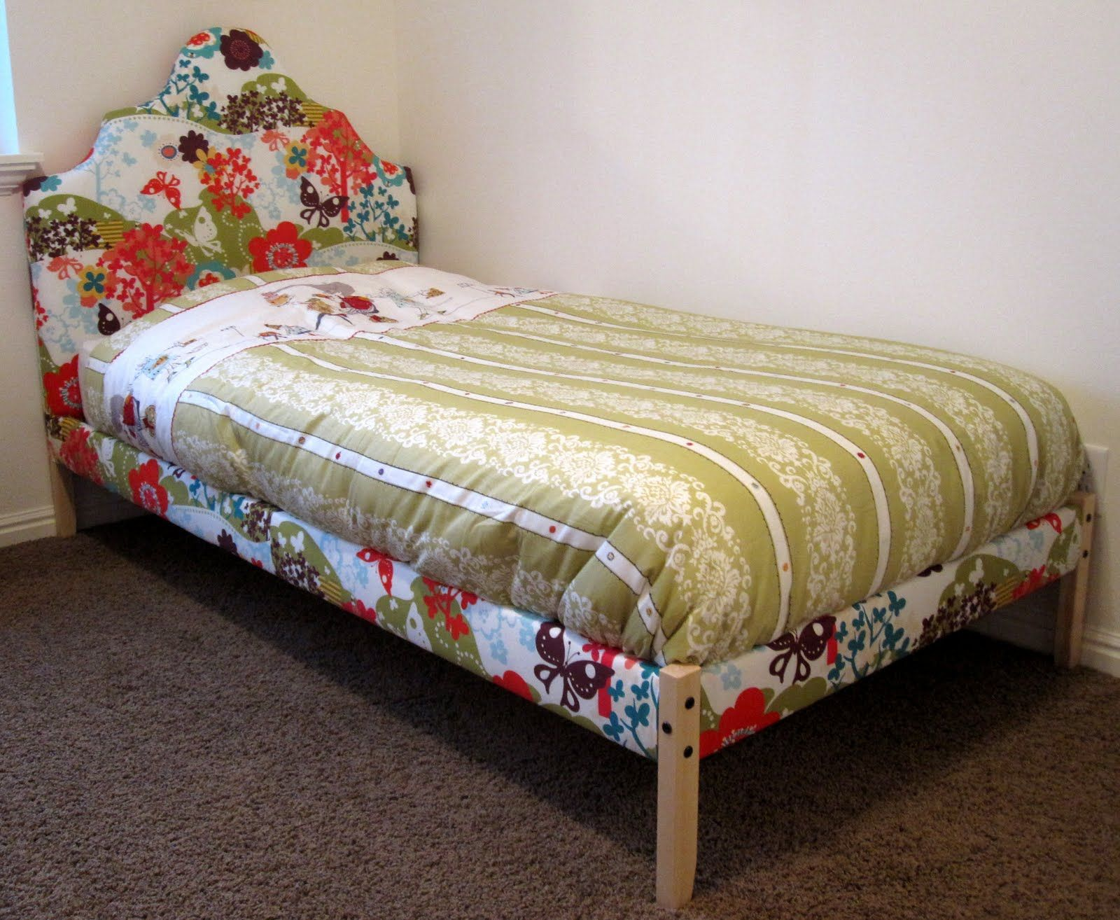 IKEA Fjellse bed upholstered Stain the legs darker to match the