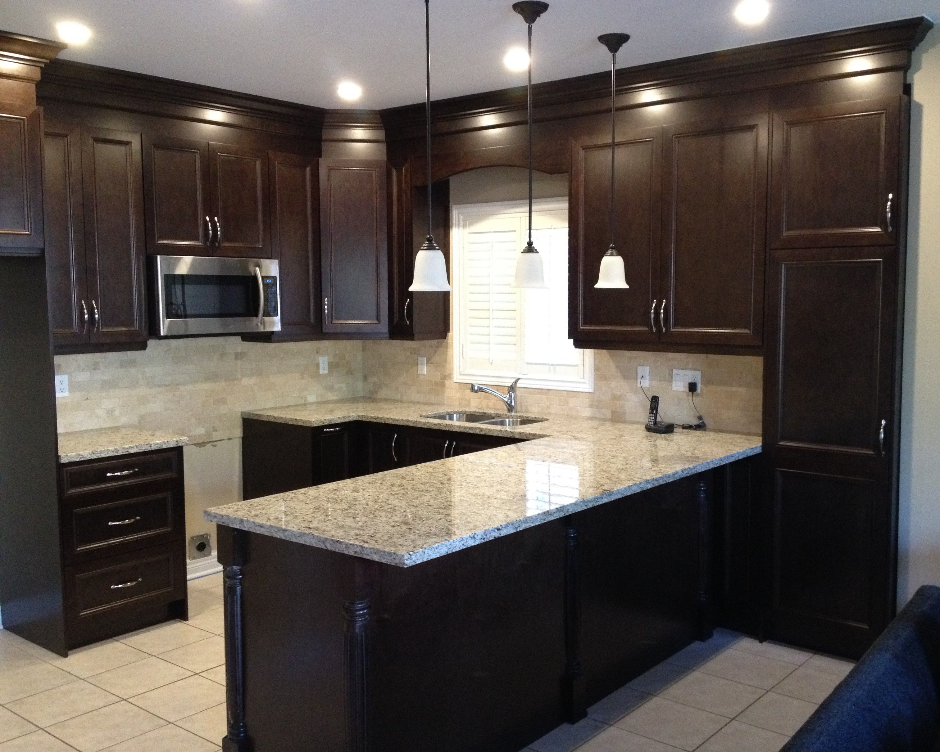 Dark kitchen cabinets give an elegant and sophisticated