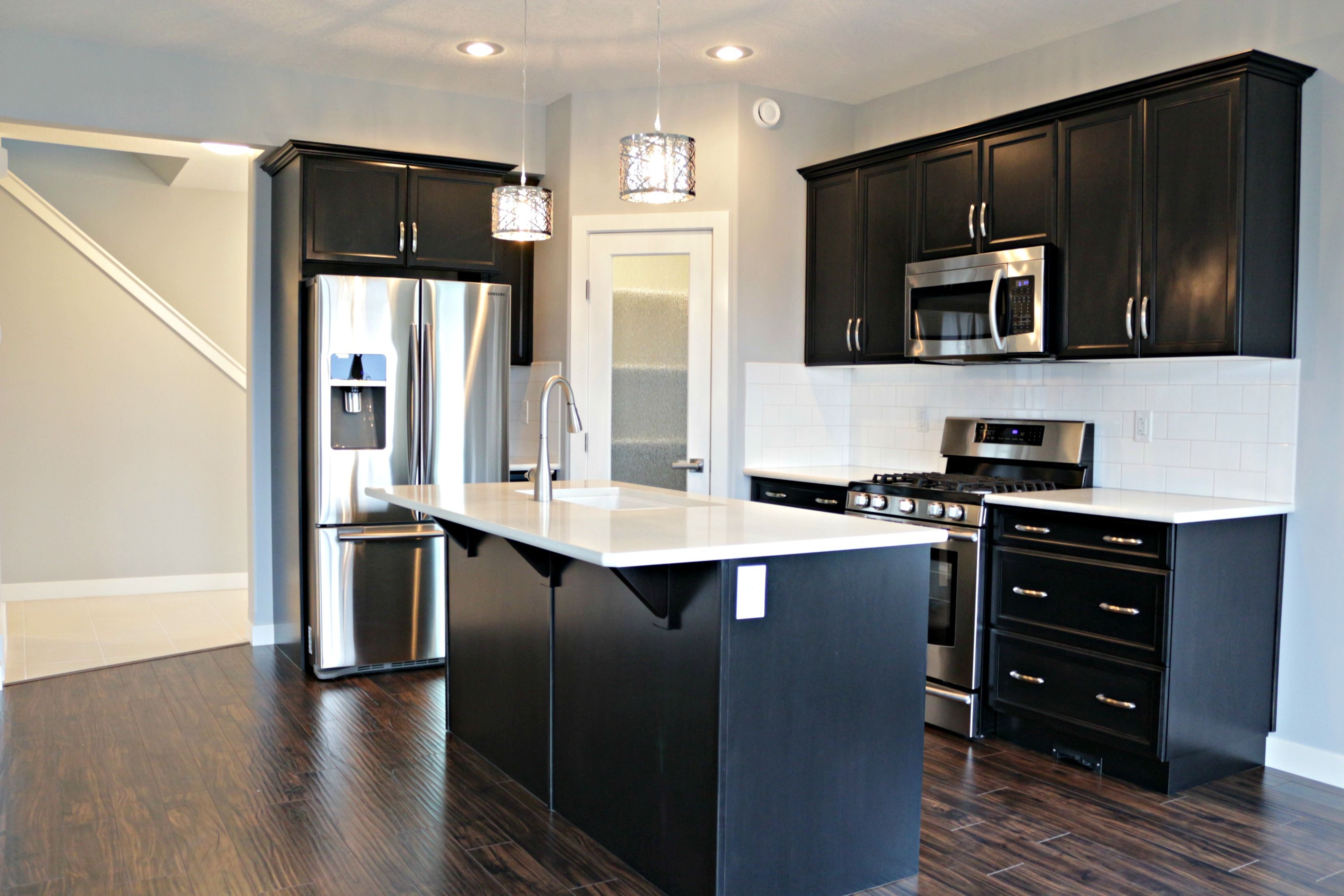 Kitchen Open Plan With Dark Cabinet: Open Concept Kitchen, Dining, And Livingroom With Dark