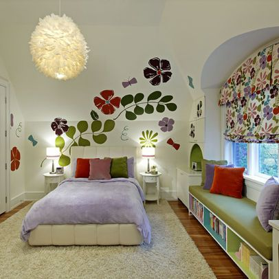 book shelves under window seat--maximize book storage in the room- I would change the flowers on the walls.