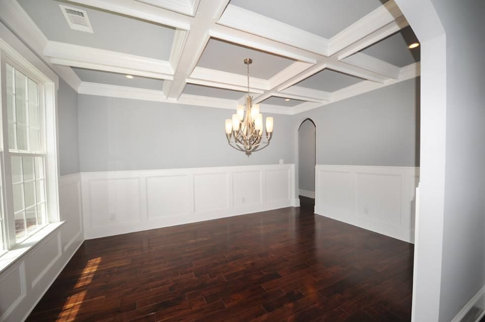 Coffered Ceilings With Light Blue Gray Walls And Dark Wood Floors Beautiful Wainscoting And Archways Light Blue Walls Vinyl Wood Flooring Blue Grey Walls
