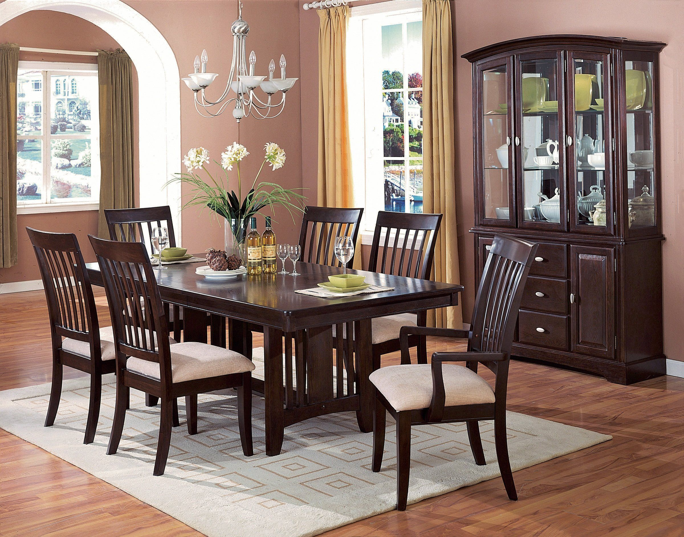 30 Rugs That Showcase Their Power Under The Dining Table Brown Dining Room Furniture Dining Room Furniture Sets Elegant Dining Room
