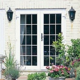 Replace Four Windows In Sunroom With Two Sets Of French Doors Like This.  The French
