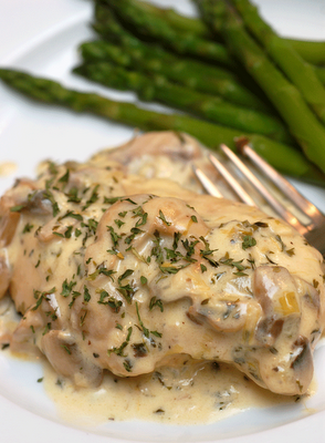 Julia Child's chicken breasts with mushrooms and white wine cream sauce.