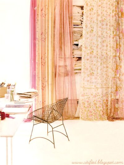Good idea for hiding a closet.  Or for replacing those horrible mirrored sliding closet doors.  This is prettier.