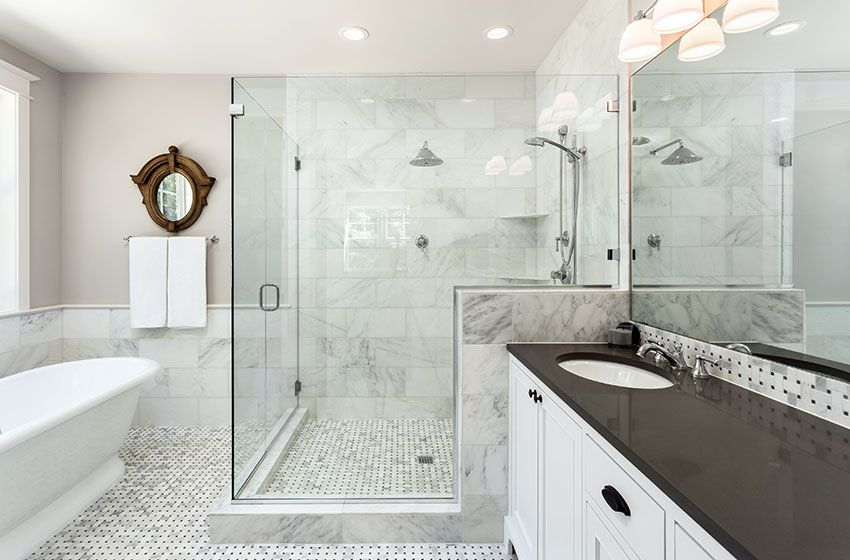 Luxury White Marble Bathroom With Large Glass Walk In Shower White Vanity With Black Countertops Bathrooms Remodel Bathroom Design Bathroom Remodel Cost