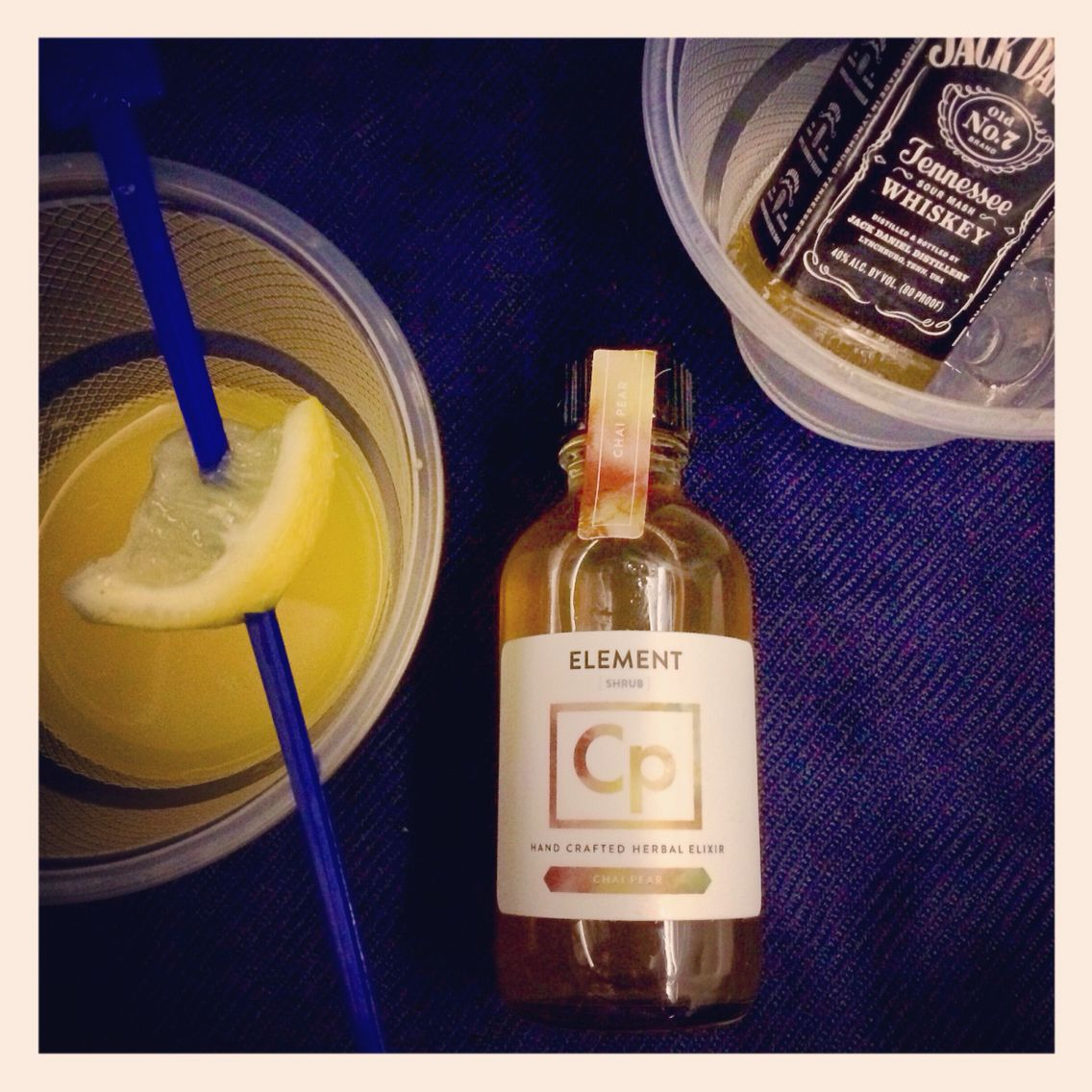 Because you shouldn't compromise on cocktails at 30,000 feet.  1/2oz Chai Pear Element shrub, 1oz jack Daniels whiskey, splash of OJ, squeeze of lemon.