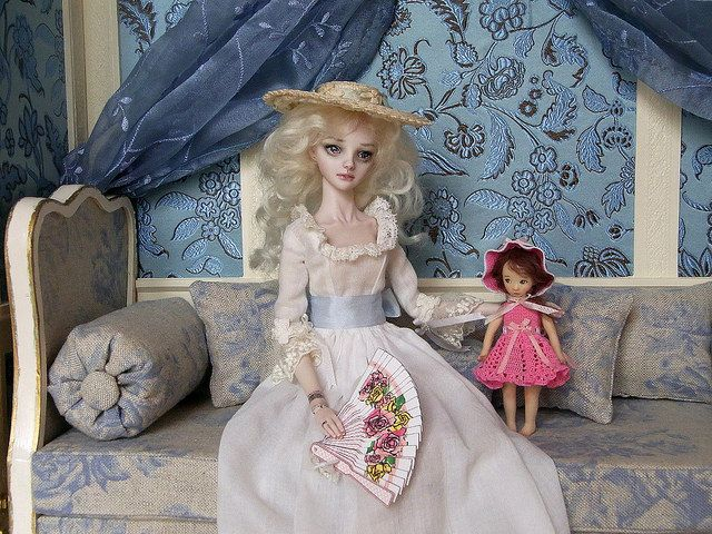 Enchanted Doll by Marina Bychkova and miniature doll by Sun Joo Lee. Both are made of porcelain.