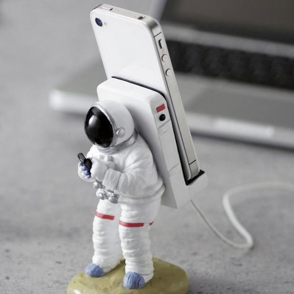 Compatible for iphones and Android phones, this astronaut phone stand holds your phone for…