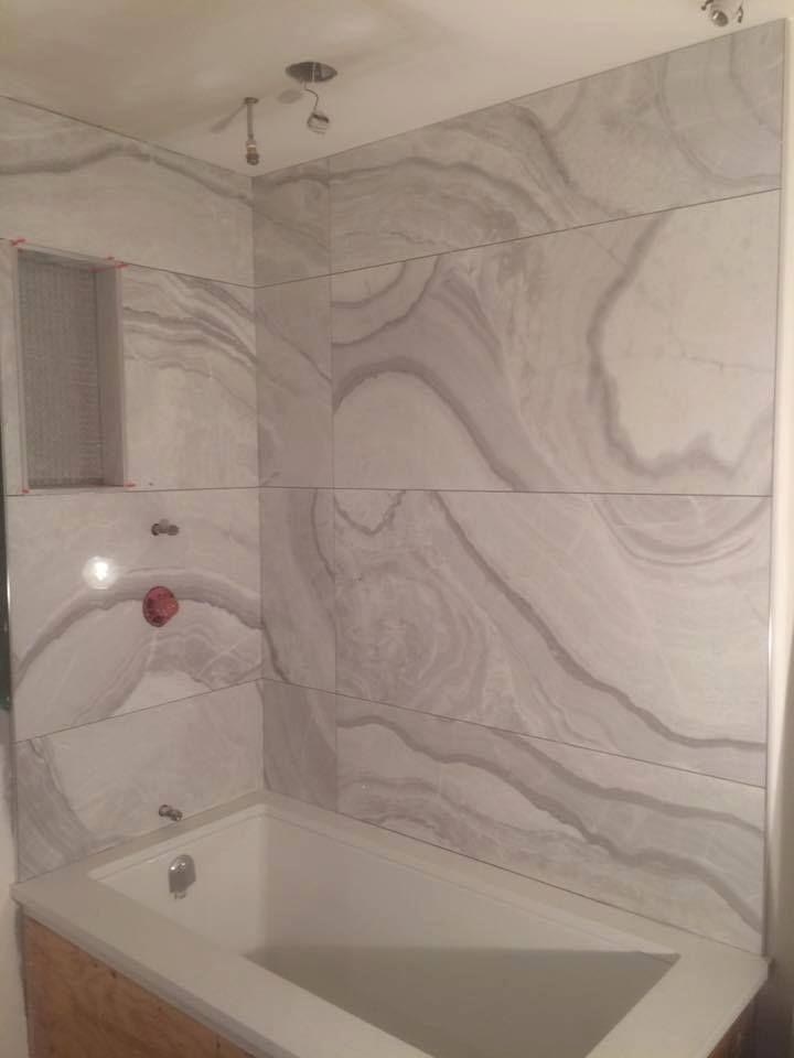 Beautiful large-format tile bathtub surround | Large-format Tile ...