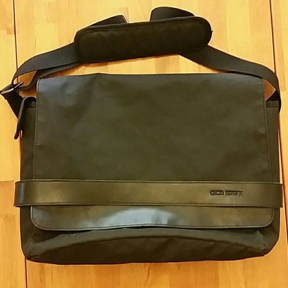 """Messenger Bag Black messenger bag by Old navy.  Height top to bottom approx. 11"""". Legnth side to side approx 14"""". Width approx 5"""". Strap legtnth approx 48"""".  Lots of zipper compartments in front. 1 side pocket. Cushioned compartment inside for laptop or tablet.  Used a few times. Very good used conditioned. Bags Laptop Bags"""