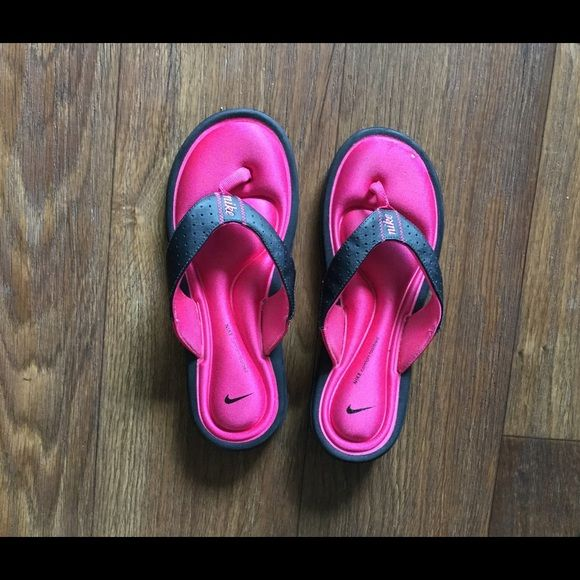 Nike comfort thongs Plush soft and comfy memory foam insoles. Nike-free outsoles. Size 8w. Black/vivid pink. Condition:Good with a lil signs of wear. Nike Shoes Sandals
