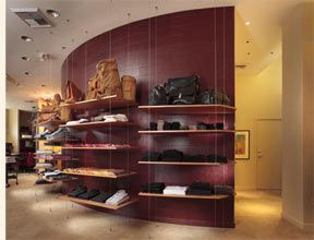 The Shelves Look Like They Are Hanging Also Curved Wall Recycled Leather Curved Walls Recycled Tile