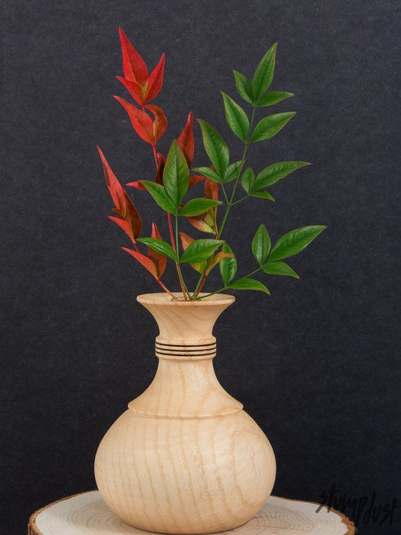 "Hand-turned Wooden Vase M8 by Stumpdust on Etsy Curvaceous vase made from salvaged ash measuring 5""h x 4""d. This vase contains a removable floral tube that can be filled with water for live arrangements or the vase can be left empty as a small sculpture. Beautiful attention to detail with decorative pyrography accent on the neck while the body is an evenly grained blonde . $55"