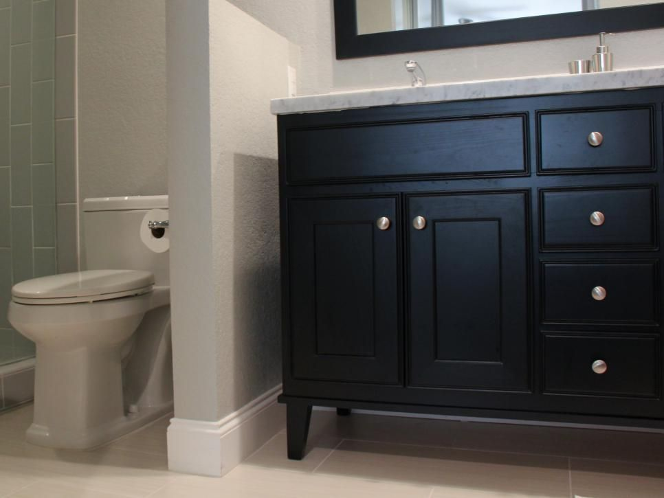 The Partial Wall In This Contemporary Bathroom Creates