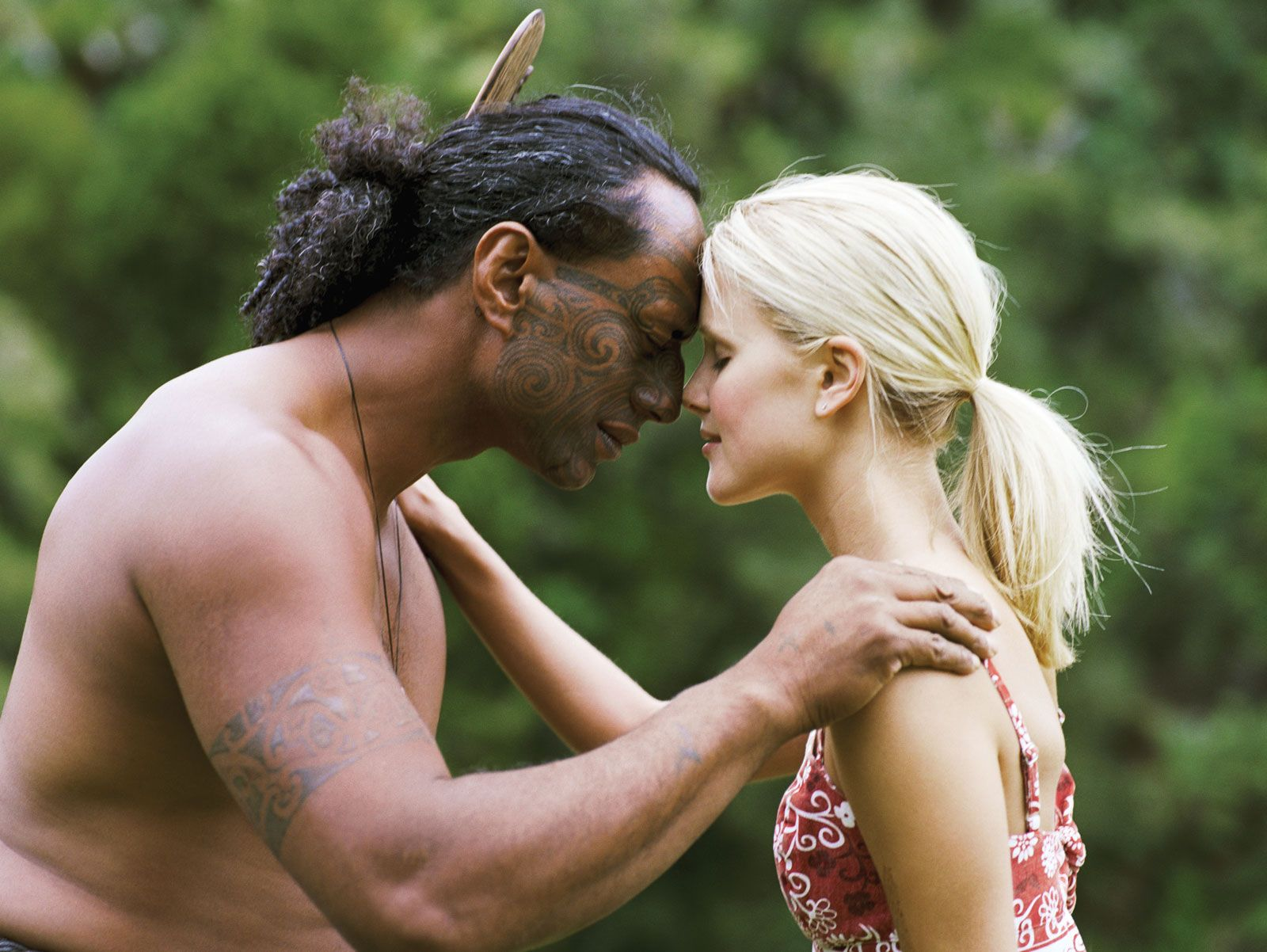 Maori maori maori man performing hongi or pressing together of noses on greeting with a m4hsunfo