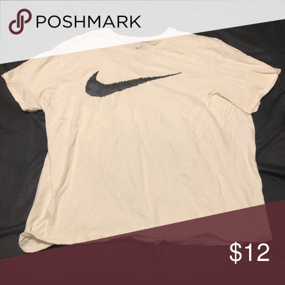 nike shirt with swoosh in middle