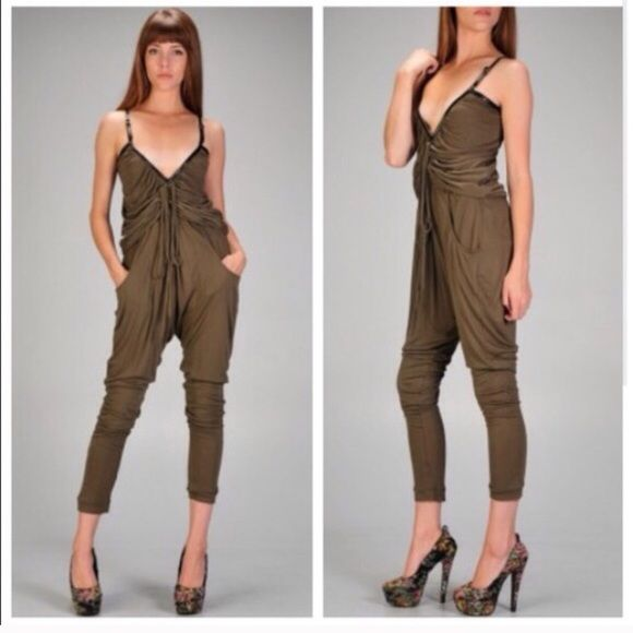"""Olive Green Jumpsuit Trending fall/winter color. Very cute. The way the front is designed, hides flaws such as a """"high"""" tummy. Faux leather trim. Fabric is not not thick or thin it's somewhere in between. And it stretches. Front Pockets! Buckle for straps! Price is firm! Dresses"""