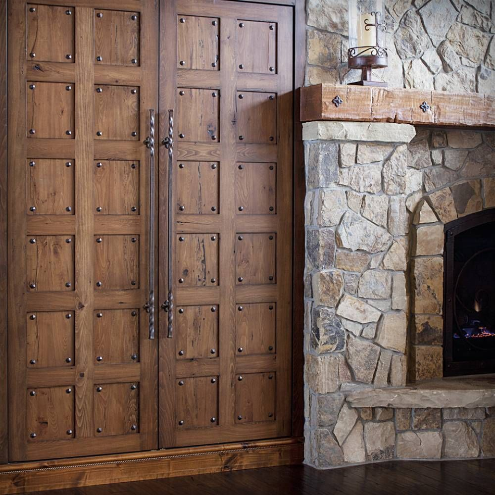 great rustic wood mantel with big castle style doors custom