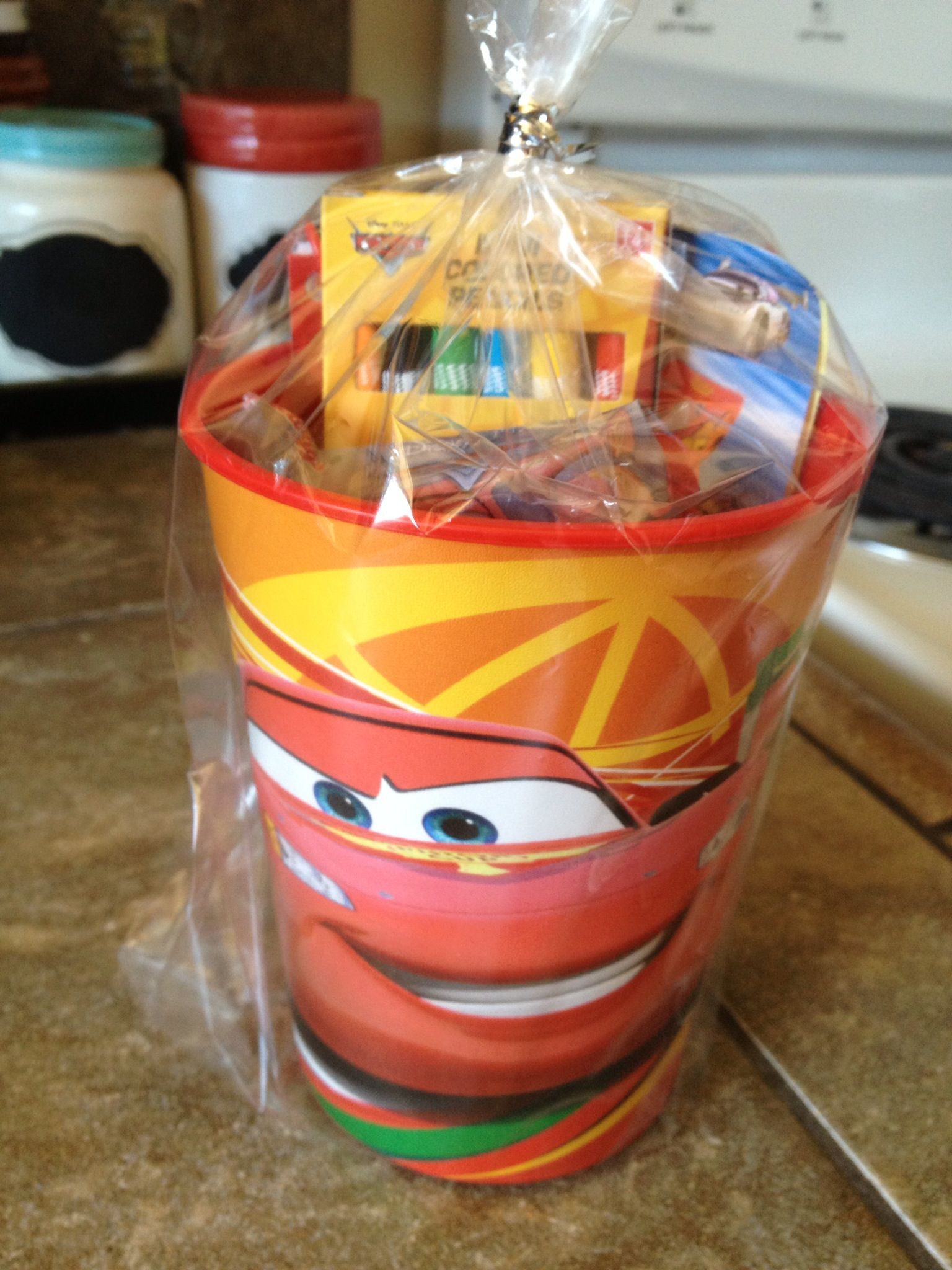 Plastic Cars cup from Target, filled with Cars crayons, Cars notepad, Cars  stickers, and Cars fruit snacks. Super easy and cheap!