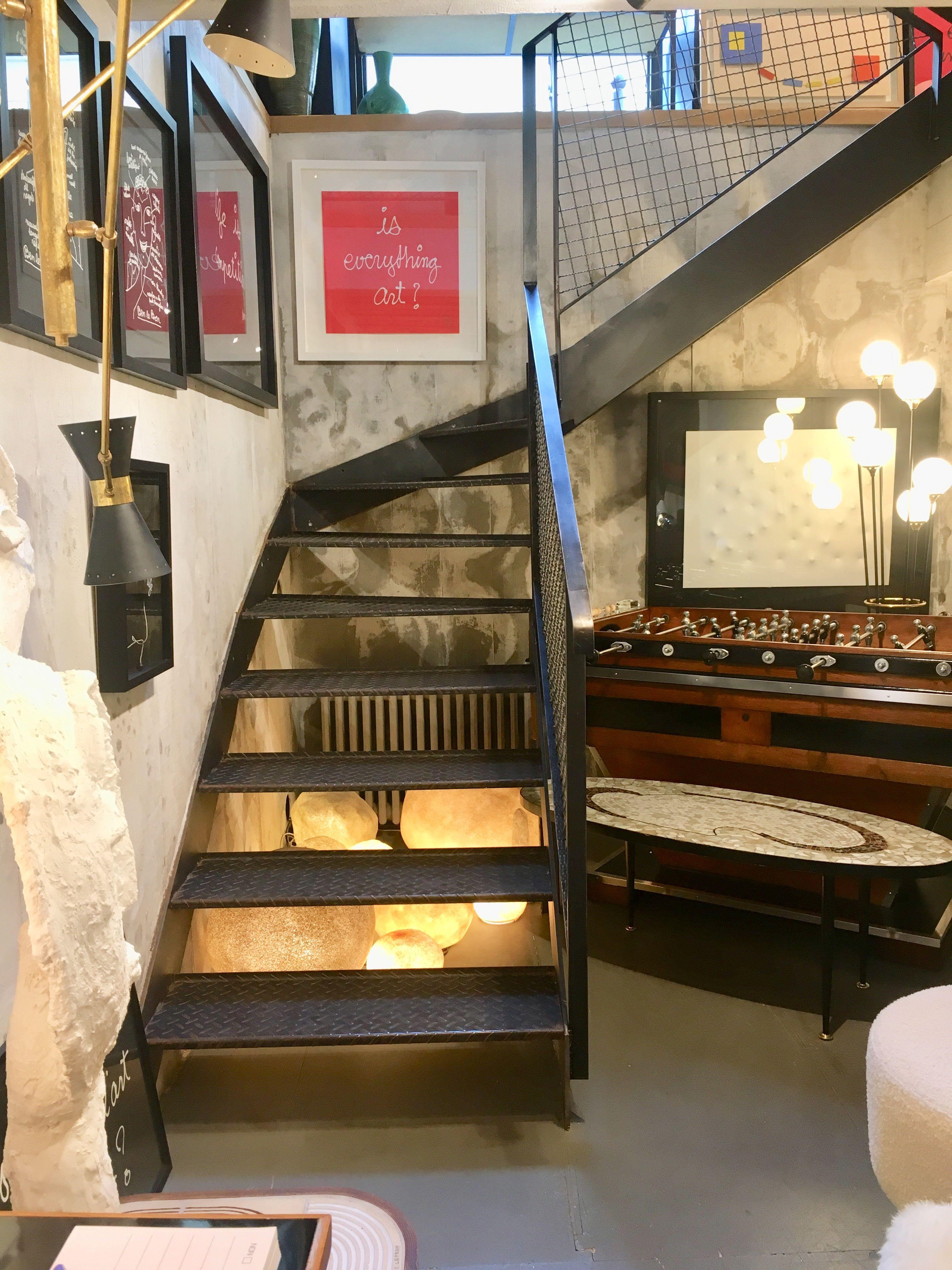 Industrial stairs in Paris vintage shop Shop design