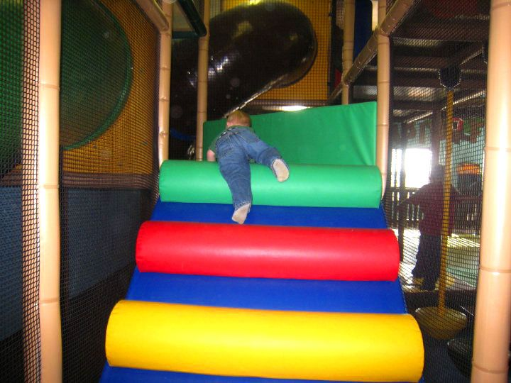 Indoor Playground Events in a play structure:  Little one climbing a MoonWalk Climb. They can be very colourful and fun to climb. International Play Company www.iplayco.com