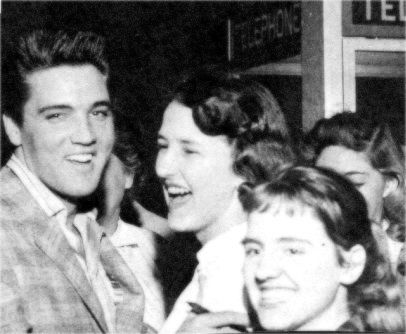 Elvis in Memphis U-S office waiting to go for Fort Chaffee , here with friends and familly.