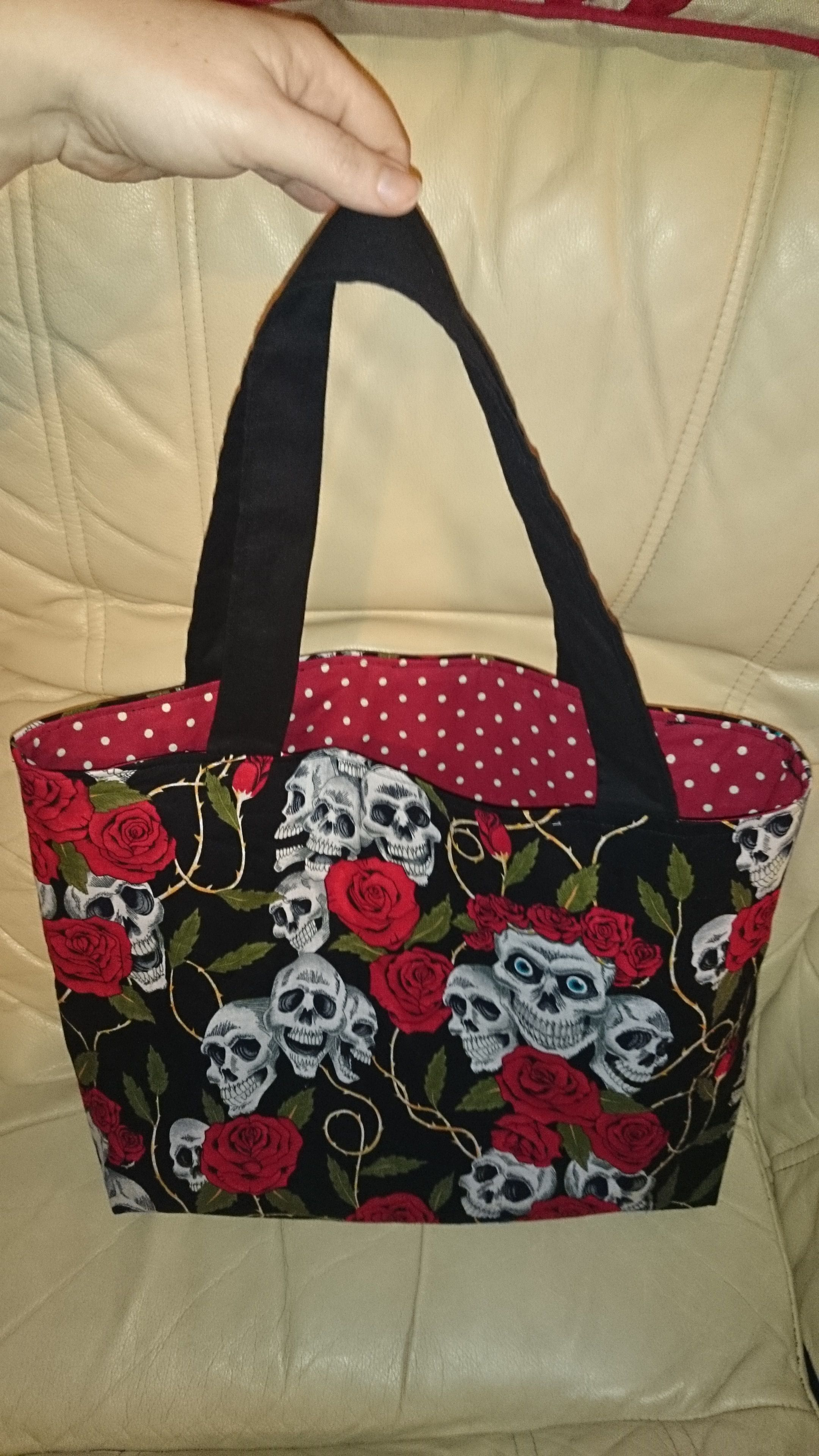 Day of the Day - Red rose & skull fabric with pokadot lining.  Handmade by Mesmerise-Ink - check out our page on facebook! #skull #rose #rockabilly #dayoftheday #handbag #gothic #