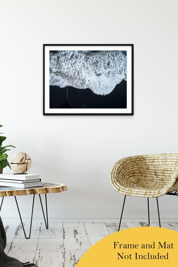 See the coast at a birds eye view everyday with this gorgeous minimal aerial coastal scene of the sea water running ashore on the black sands of Iceland. Photo created by: Tawatchai Prakobkit.    High quality luster coated unframed photo prints are available in a variety of sizes, click the image to learn more. #wallart #walldecor #landscapephotography #landscapes #coastal #beach #iceland