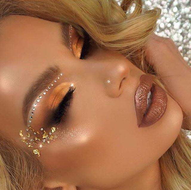 Golden eyeshadow with rhinestones