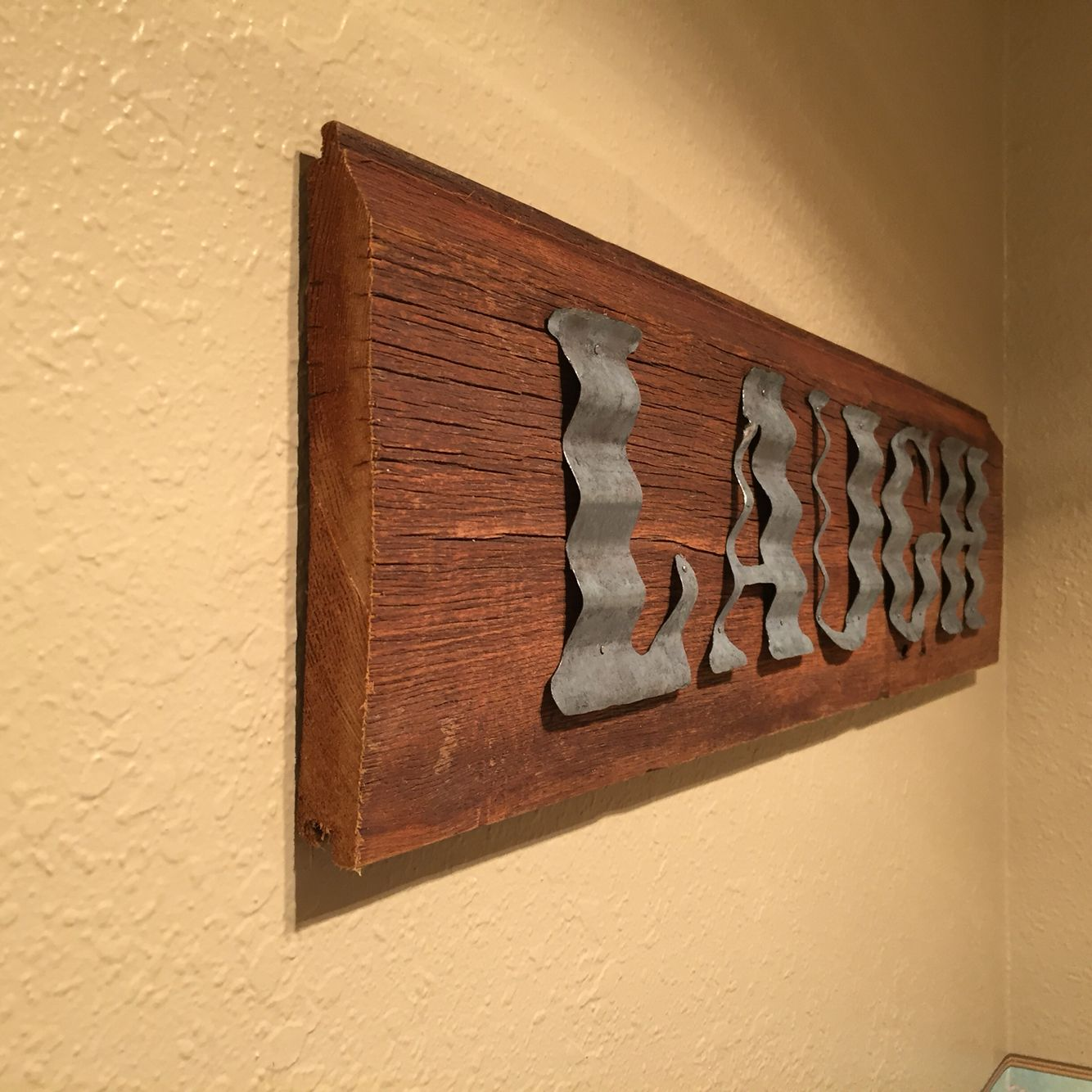 Old barn wood and galvanized steel sign