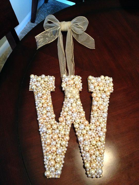 i glued jewelry pearls i found at hobby lobby onto a wooden letter i also got at hobby lobby using mixed media glue i tied a ribbon around the center and