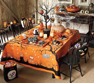 unique halloween tablescapes | So I love the tree centerpiece and the personalized chair bags!