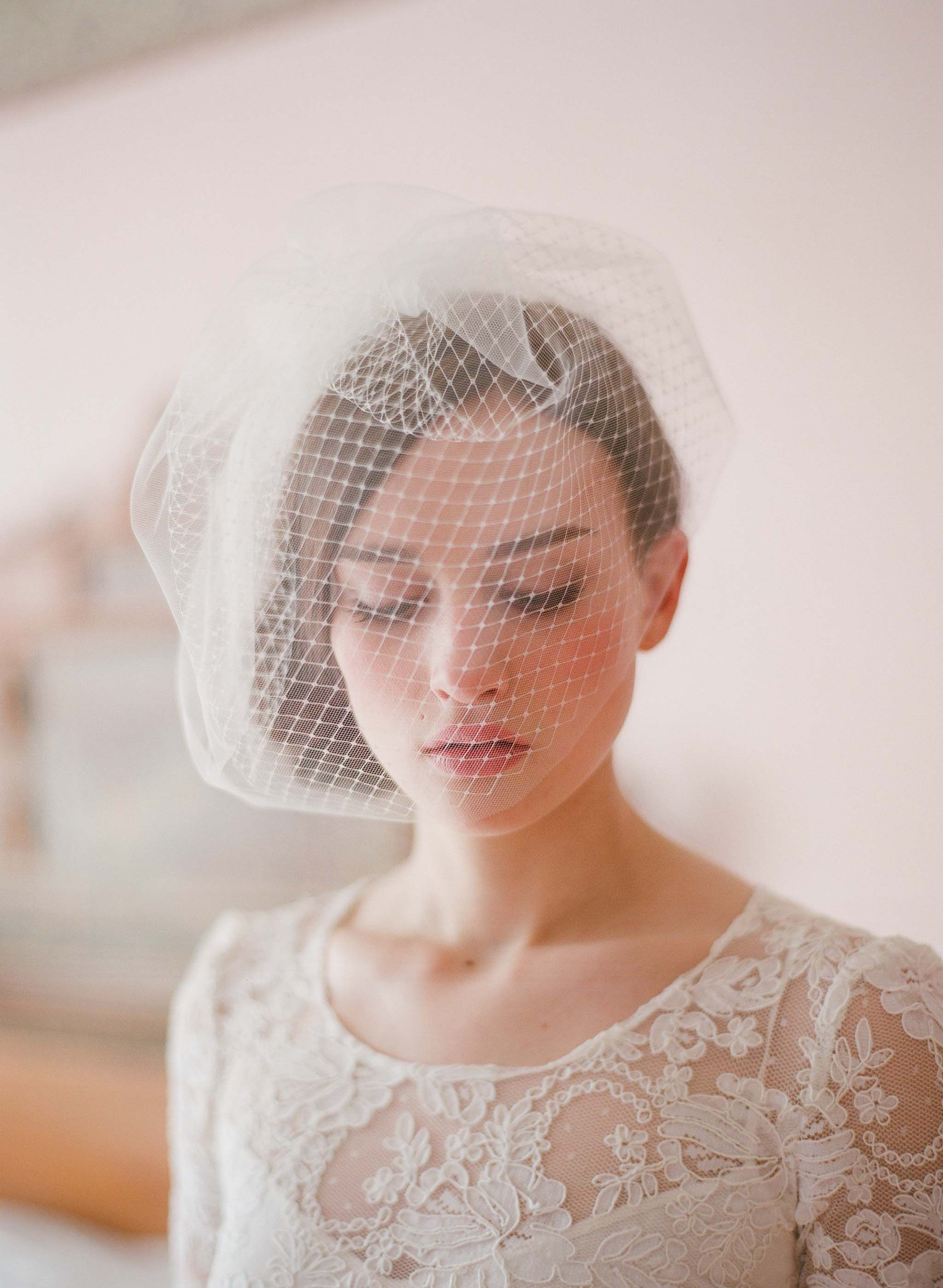 Lace and birdcage head piece. Twigs and honey.