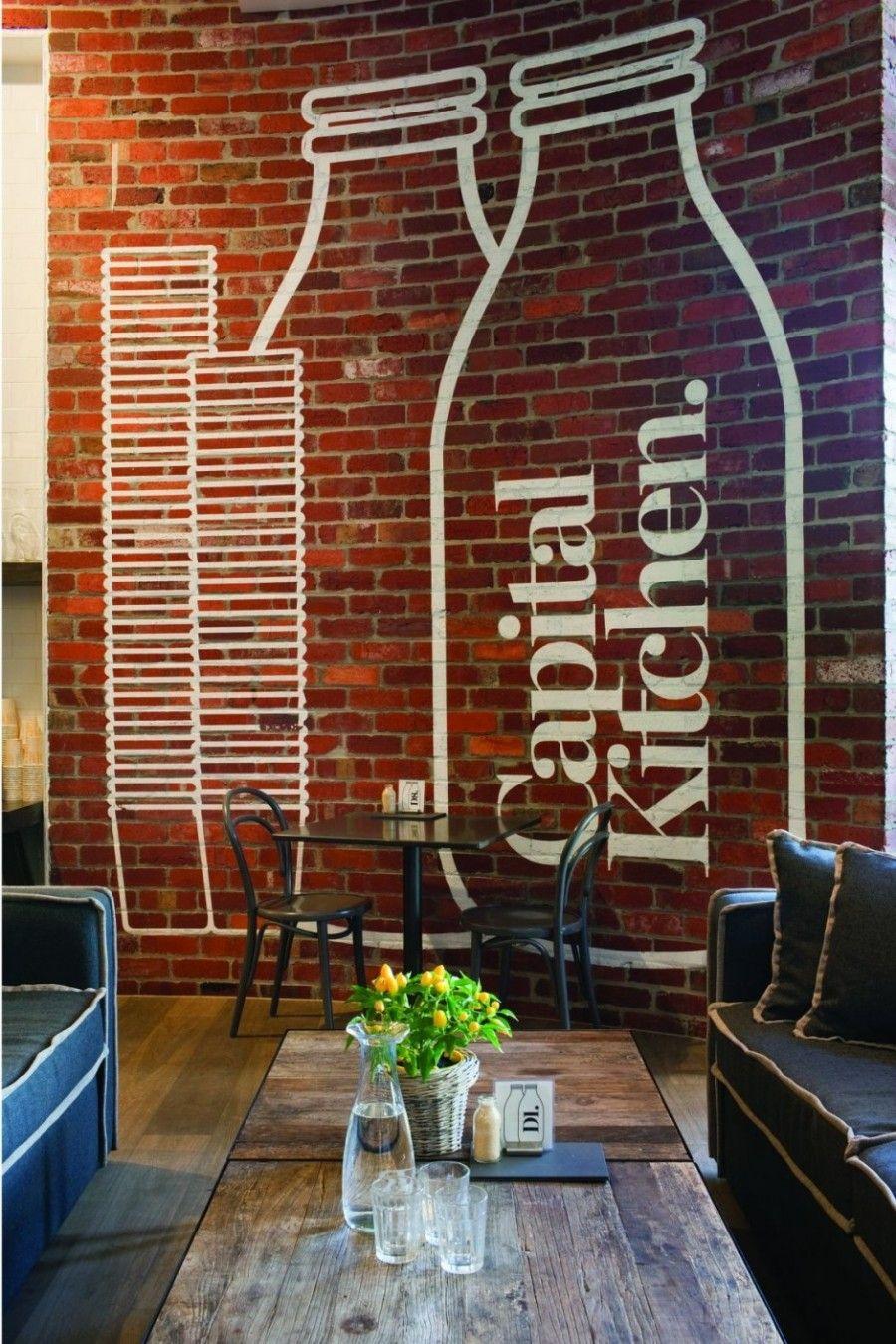 painted graphics on exposed brick wall  brick interior