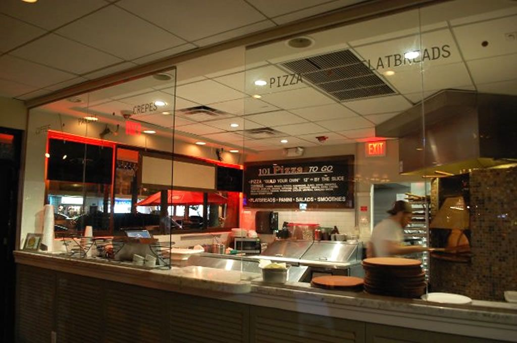 Restaurant Kitchen Gallery use counters + glass walls to section off the kitchen in a mixed