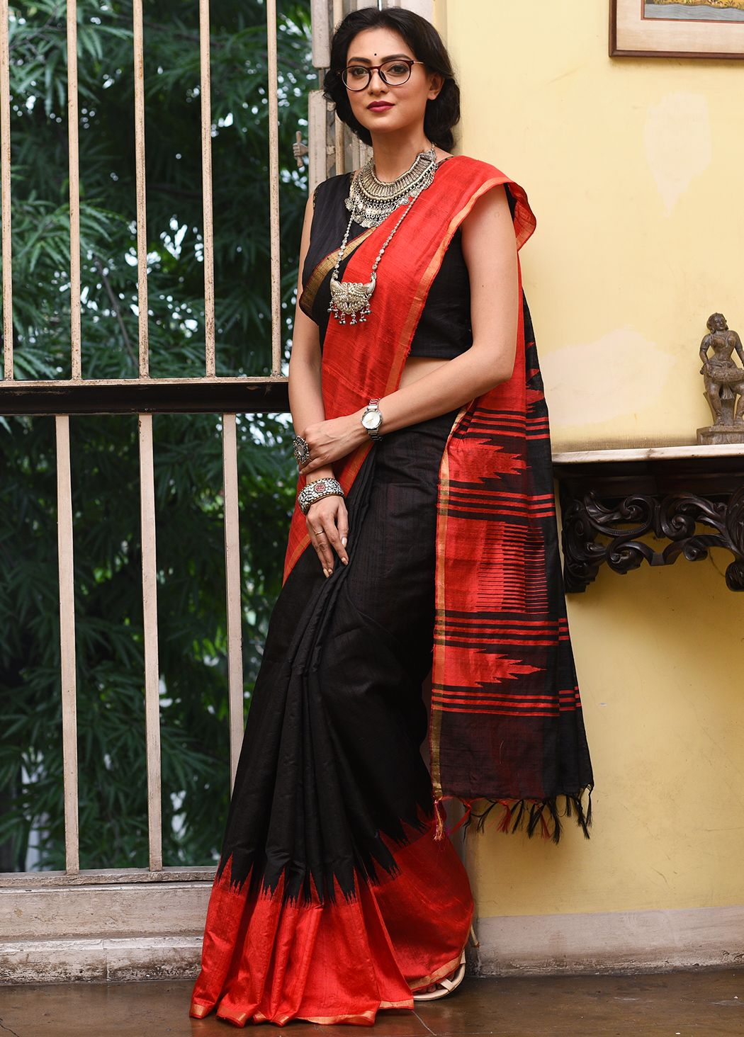 da08dbc11a5761 Rich black pure dupion silk saree featuring plain textured body ...