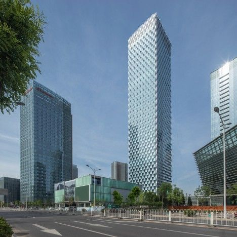 Trapezoidal glass panels create prismatic facades for SOM's Beijing skyscraper