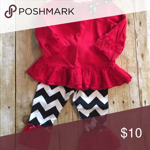 12 month 2 piece set Black ruffles chevron pants and red ruffles shirt. 100% cotton with polyester sparked trim. Only worn twice. decorated originals Matching Sets