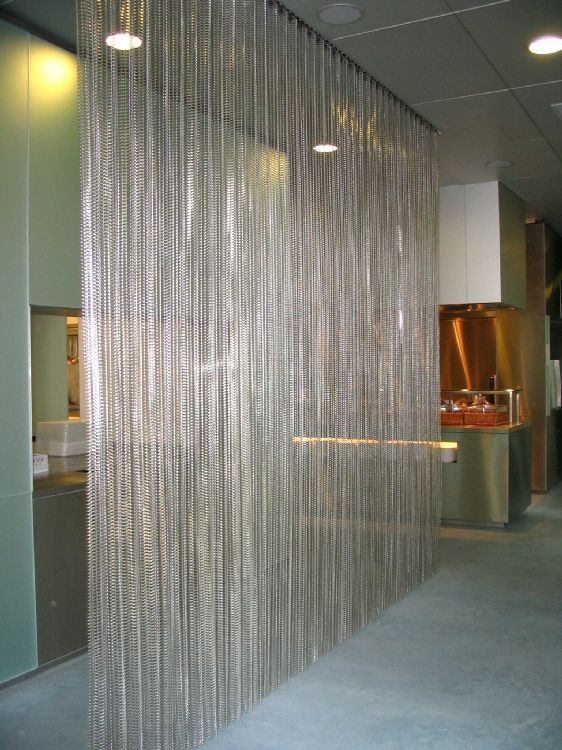 A luxury metal curtain as a room divider at a companies restaurant