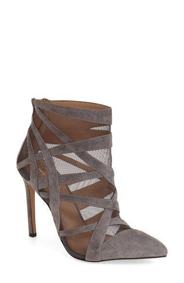 7ff181553f7 ... (Women) at Nordstrom.com. Crisscrossed straps and illusion-mesh insets  add to the drama of a pointy-toe bootie lifted by a contemporary setback  heel.