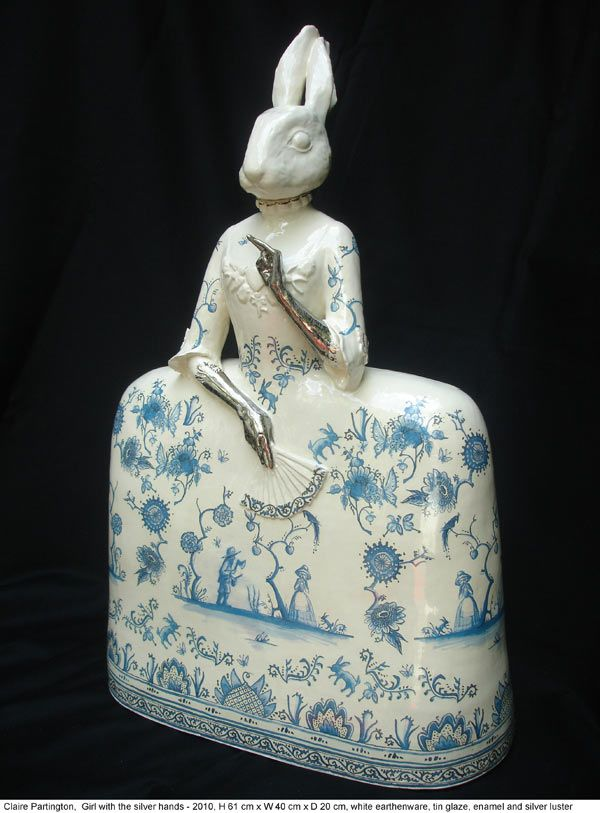 Contemporary ceramic sculpture artist Claire Partington. -Girl with the silver hands