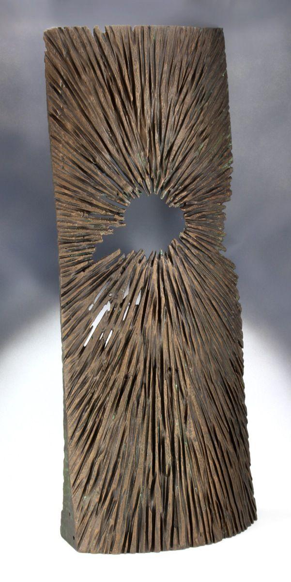 "Bronzed wood sculpture, ""Beginnings"""