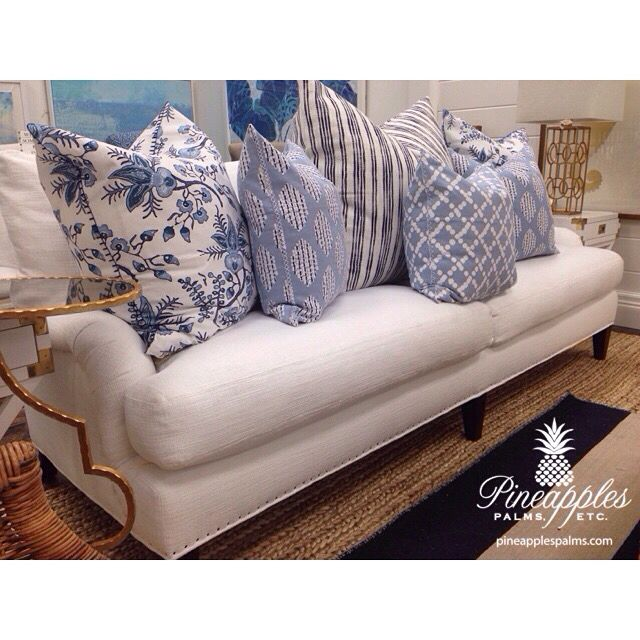 White sofa with blue and white throw pillows at Pineapples, Palms, Etc in Jupiter, Florida 561-748-8303