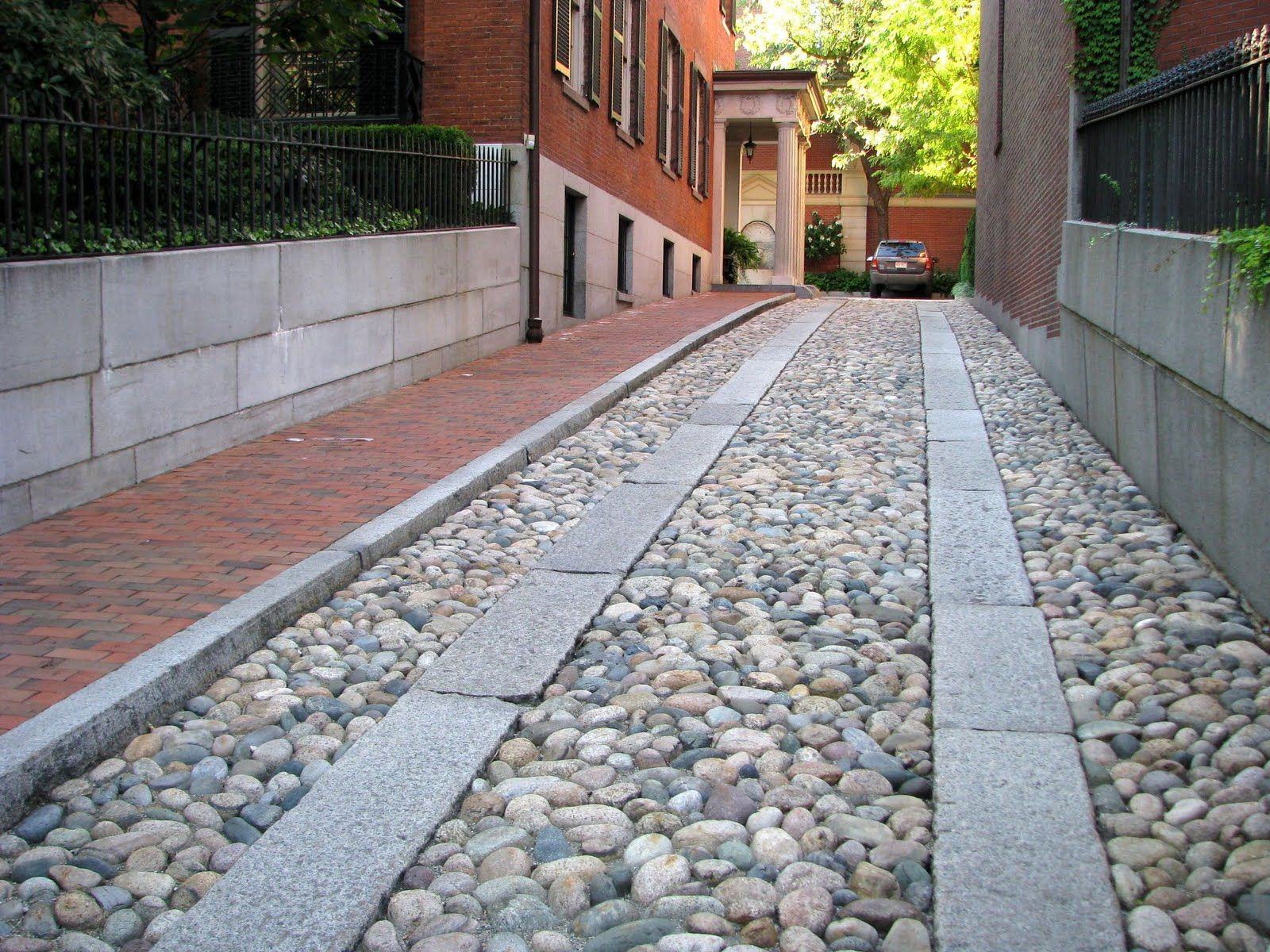 Granite pavers define the path in this river rock cobblestone granite pavers define the path in this river rock cobblestone driveway on mount vernon street solutioingenieria Choice Image