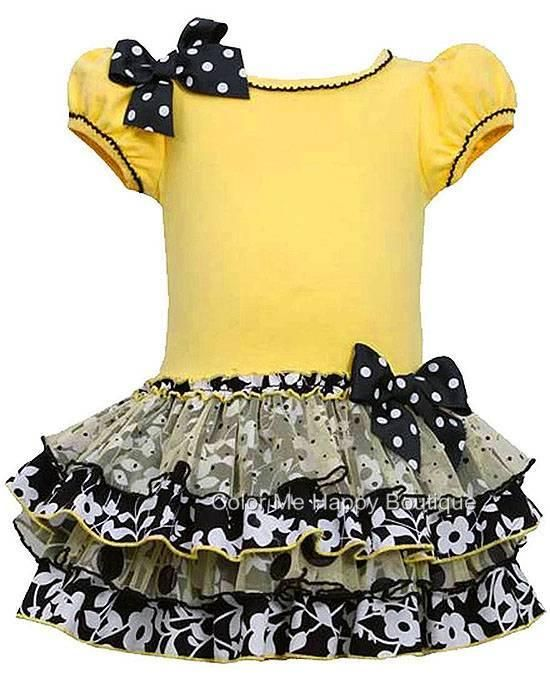 dde8c2693449 This CHARMING yellow and black short-sleeved dress for your baby ...
