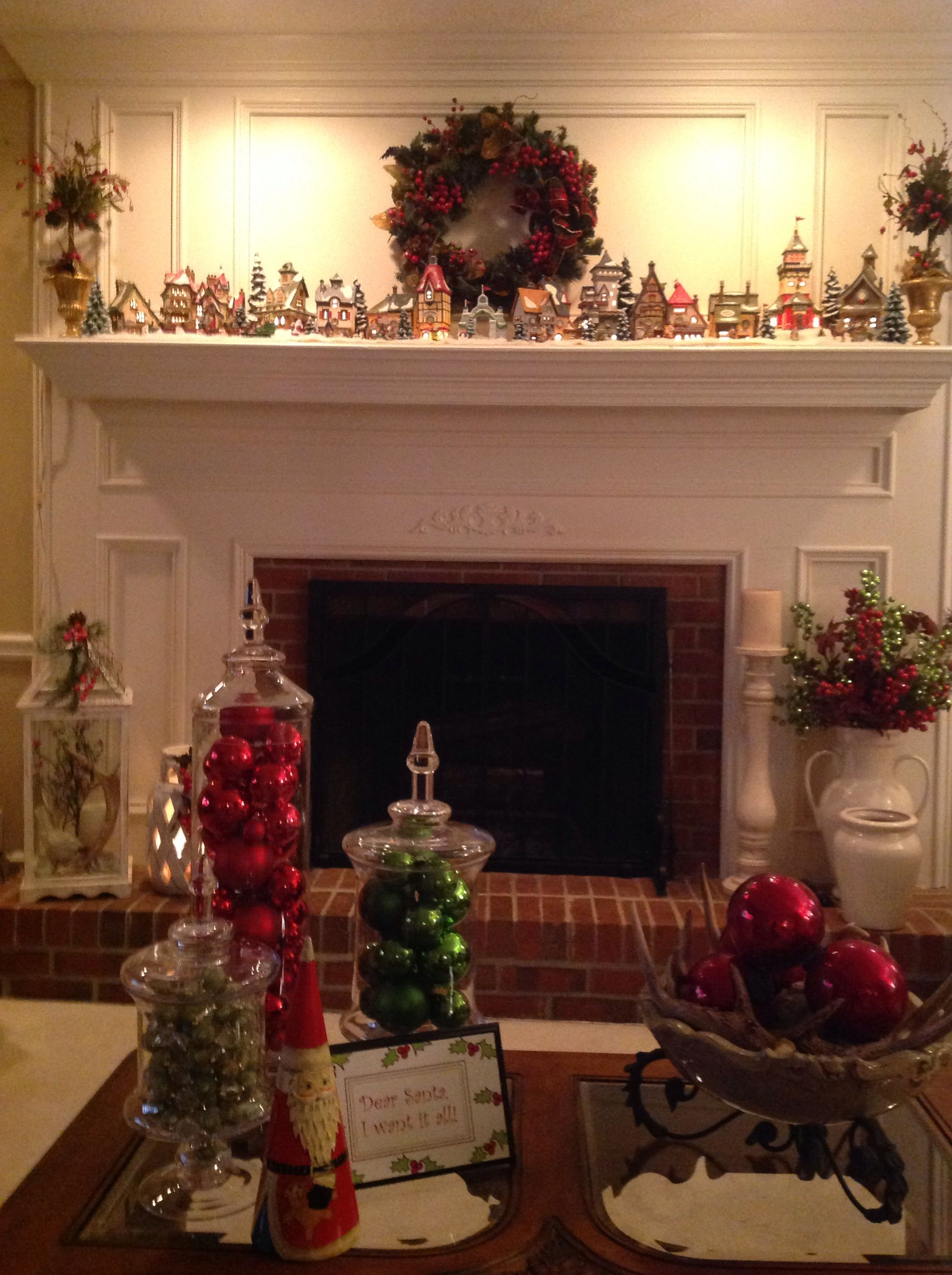 North Pole Village on mantel and lovely decor around the room Love