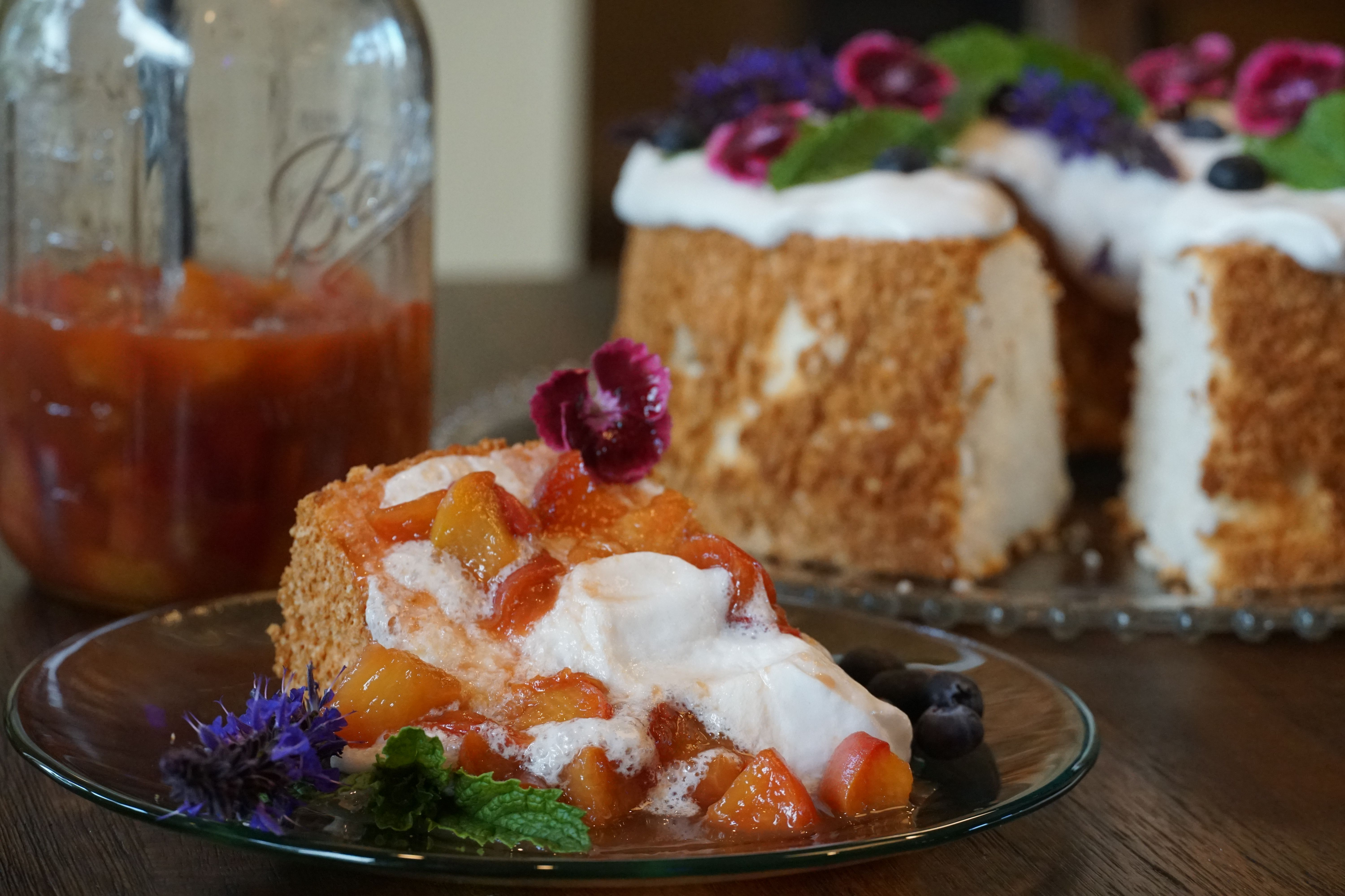 Almond angel food cake with whiskey brown sugar peaches